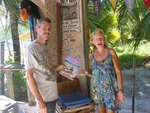 Robin buying a copy of Cruising Outpost at Corsairs on Jost Van Dyke